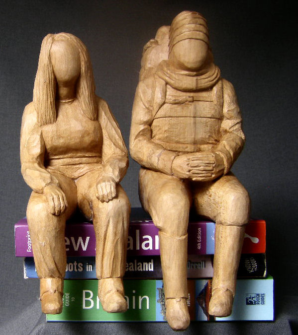 Carved sitting figures